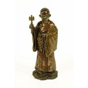 Figura monje tibetano con campana