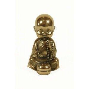 Figura niño monje tocando