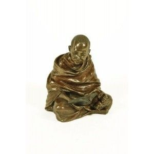 Figura monje tibetano sentado